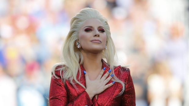 Lady Gaga places her hand over her heart after singing the U.S. National Anthem before the start of the NFL's Super Bowl 50 football game between the Carolina Panthers and the Denver Broncos in Santa Clara, California February 7, 2016. REUTERS/Mike Blake