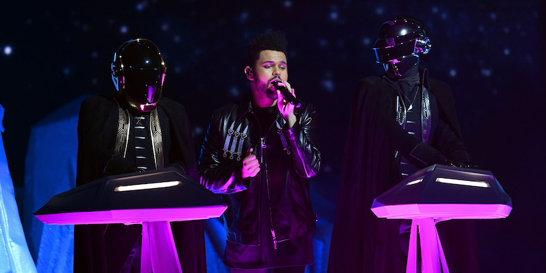 LOS ANGELES, CA - FEBRUARY 12: Recording artist The Weeknd (C) and music group Daft Punk perform onstage during The 59th GRAMMY Awards at STAPLES Center on February 12, 2017 in Los Angeles, California. (Photo by Kevin Winter/Getty Images for NARAS)