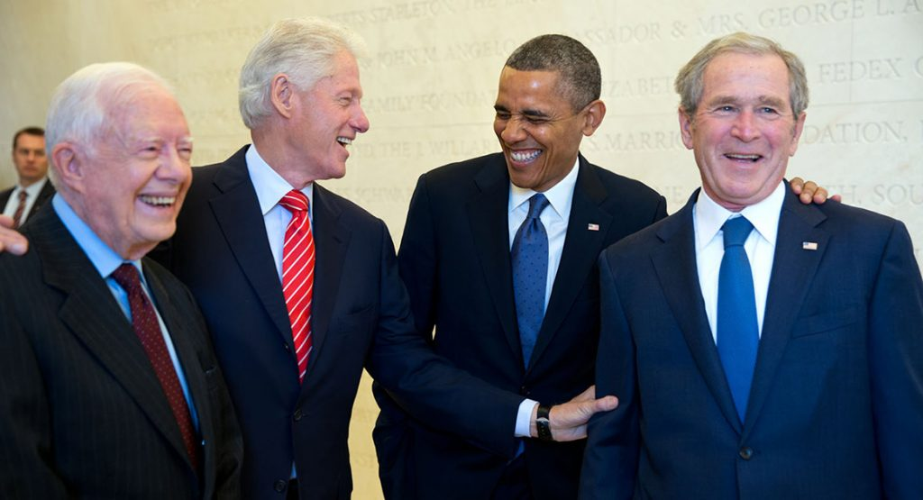 """April 25, 2013 """"Four Presidents. One funny story. Presidents Carter, Clinton, Obama and Bush wait backstage to be introduced during the dedication of the George W. Bush Presidential Library and Museum on the campus of Southern Methodist University in Dallas.""""  (Official White House Photo by Pete Souza) This official White House photograph is being made available only for publication by news organizations and/or for personal use printing by the subject(s) of the photograph. The photograph may not be manipulated in any way and may not be used in commercial or political materials, advertisements, emails, products, promotions that in any way suggests approval or endorsement of the President, the First Family, or the White House."""
