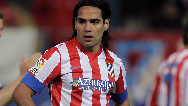 Atletico de Madrid's Radamel Falcao from Colombia, centre, pauses during a Spanish La Liga soccer match against Real Madrid at the Vicente Calderon stadium in Madrid, Spain, Saturday, April 27, 2013. (AP Photo/Andres Kudacki)