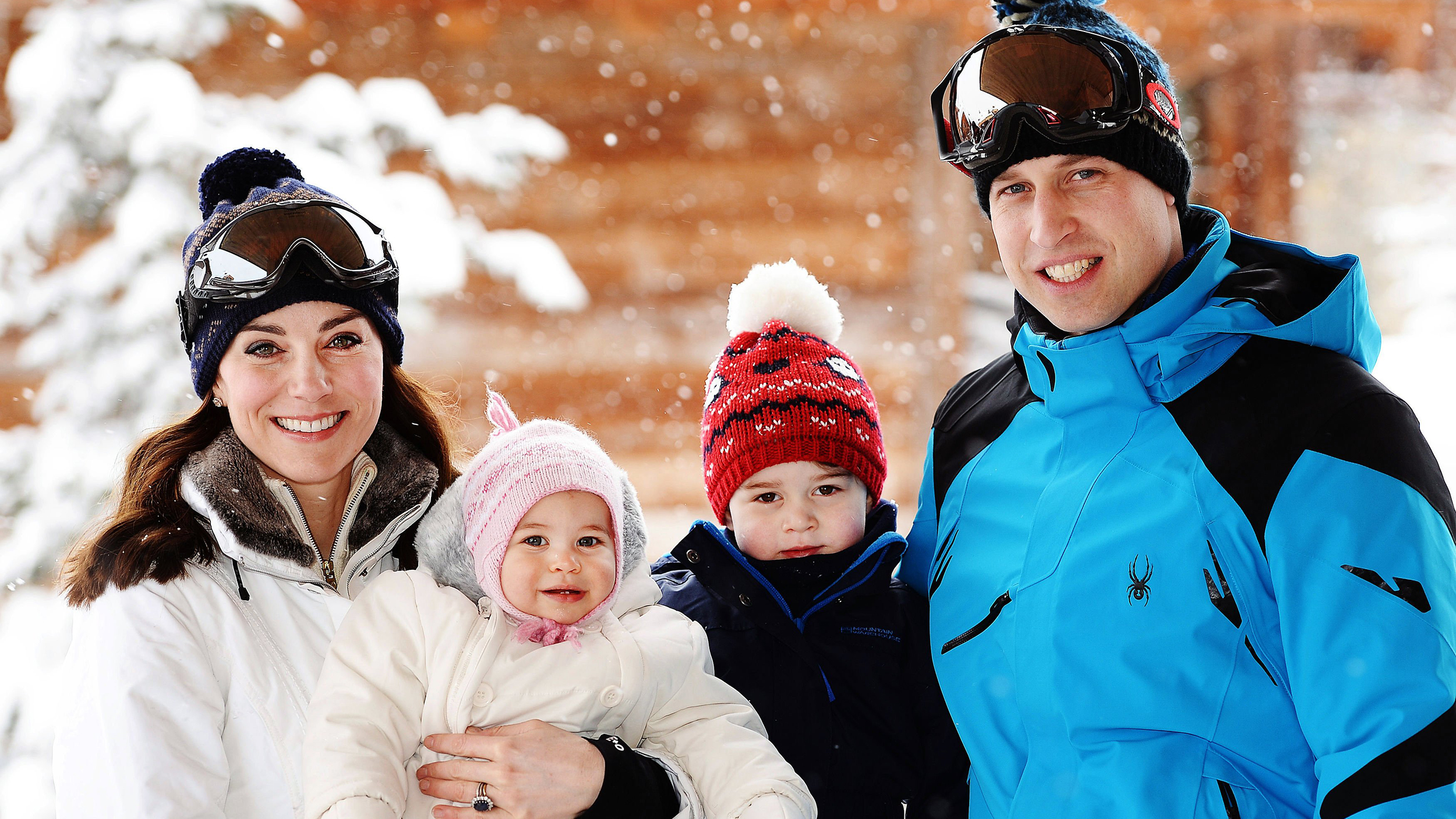 Britain's Prince William, right, and Duchess of Cambridge with their children, Princess Charlotte, centre left, and Princess George, enjoy a short private break skiing in the French Alps, Thursday March 3, 2016.  This is the first time the family of four have taken a holiday together. (John Stillwell/Pool via AP) NO COMMERCIAL USE