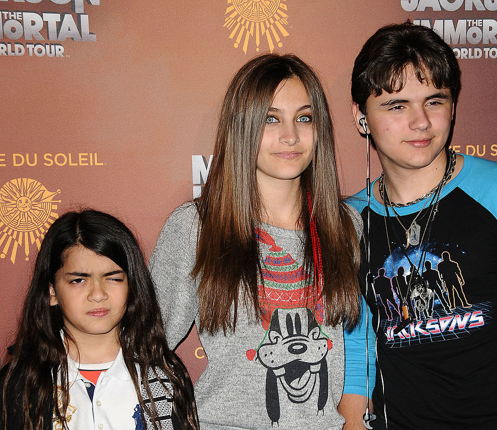 "LOS ANGELES, CA - JANUARY 27:  (L-R) Blanket Jackson, Paris Jackson and Prince Michael Jackson attend the Los Angeles opening of ""Michael Jackson THE IMMORTAL World Tour"" at Staples Center on January 27, 2012 in Los Angeles, California.  (Photo by Jason LaVeris/FilmMagic)"