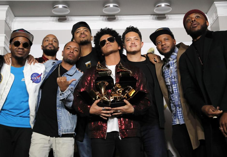 "60th Annual Grammy Awards – Photo Room – New York, U.S., 28/01/2018 – Bruno Mars poses with his Grammys for Record of the Year and Album of the Year for ""24K Magic"" and Song of the Year for ""That's What I Like"". REUTERS/Andrew Kelly"
