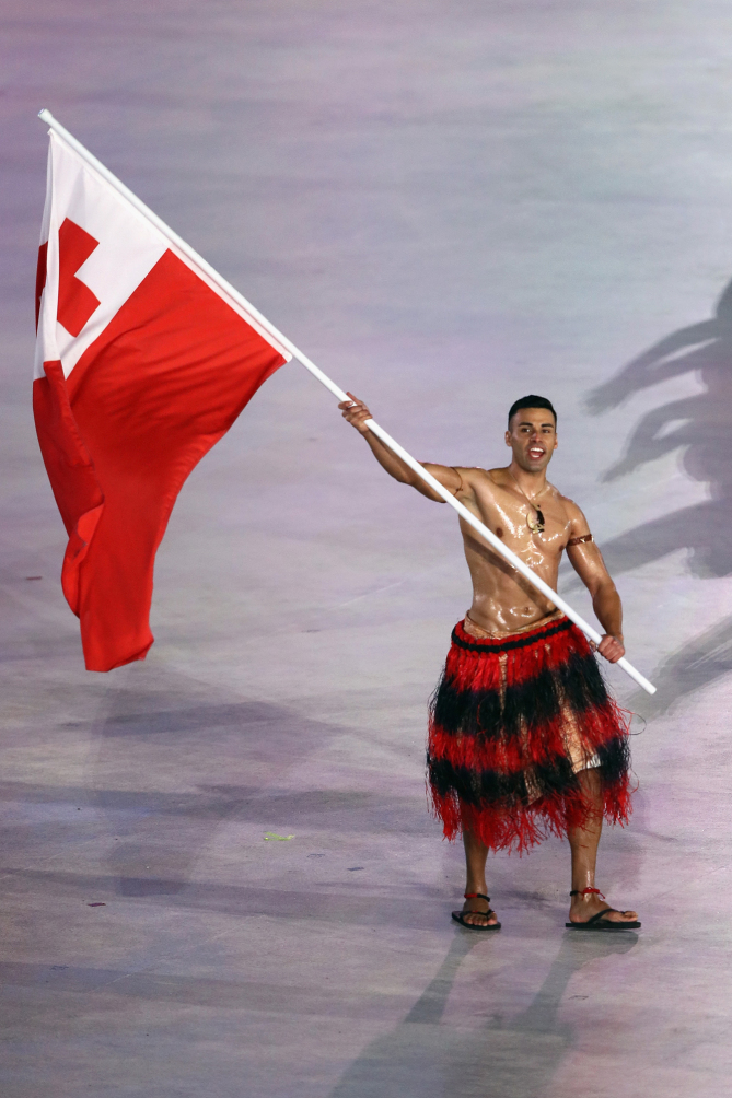 PYEONGCHANG-GUN, SOUTH KOREA - FEBRUARY 09: Flag bearer Pita Taufatofua of Tonga leads the team during the Opening Ceremony of the PyeongChang 2018 Winter Olympic Games at PyeongChang Olympic Stadium on February 9, 2018 in Pyeongchang-gun, South Korea. (Photo by Jamie Squire/Getty Images)