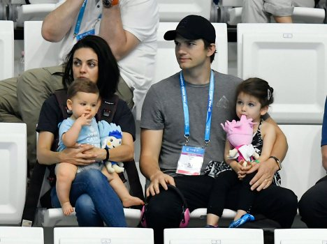 US actress Mila Kunis, left, and her husband US actor Ashton Kutcher, center, are seen with their children during the women's 3m synchro springboard final of the 17th FINA Swimming World Championships in Duna Arena in Budapest, Hungary, Monday, July 17, 2017. (Tibor Illyes/MTI via AP)