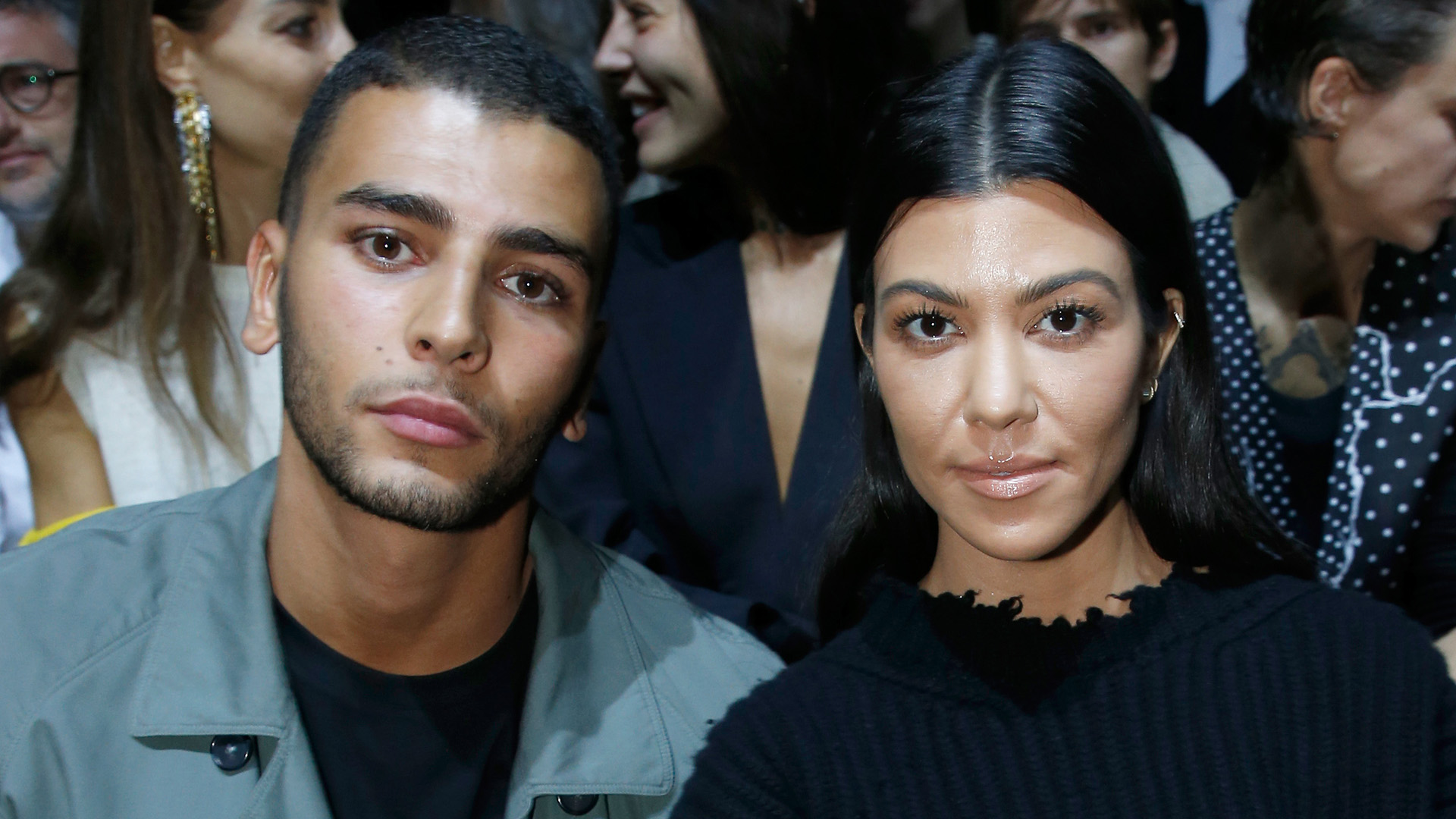 PARIS, FRANCE - SEPTEMBER 30:  Kourtney Kardashian (L) and her companion Younes Bendjima (R) attend the Haider Ackermann show as part of the Paris Fashion Week Womenswear  Spring/Summer 2018 on September 30, 2017 in Paris, France.  (Photo by Bertrand Rindoff Petroff/Getty Images)