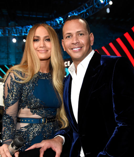 "LOS ANGELES, CA - OCTOBER 14: In this handout photo provided by One Voice: Somos Live!, singer Jennifer Lopez (L) and Alex Rodriguez pose onstage during ""One Voice: Somos Live! A Concert For Disaster Relief"" at the Universal Studios Lot on October 14, 2017 in Los Angeles, California. (Photo by Kevin Mazur/One Voice: Somos Live!/Getty Images)"