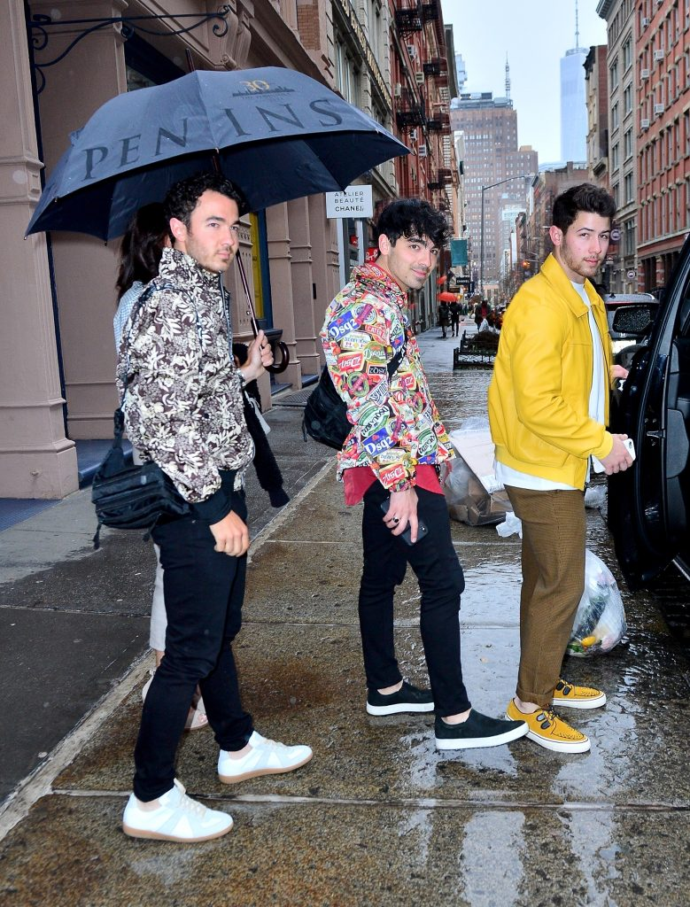 The Jonas Brothers are all smiles as they step out for dinner in NYC